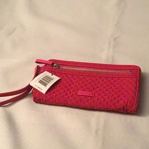 NWT iconic rfid front zip wristlet passion pink